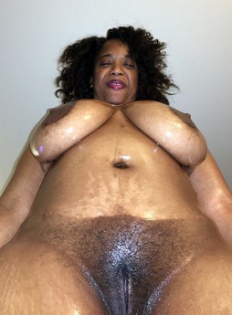 Large black granny with big melons and..